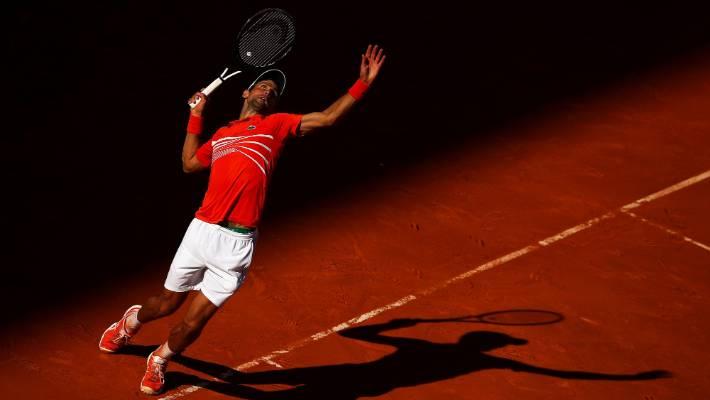 Novak Djokovic in action against Dominic Thiem.