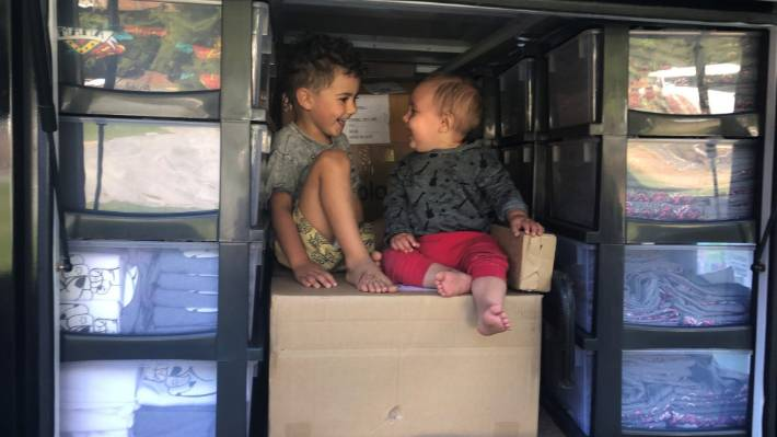 River (left) and Mack have a bit of fun among the stock boxes in the back of the truck.