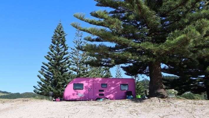 It's not hard to spot the hot pink caravan when the family rock up to a holiday park.