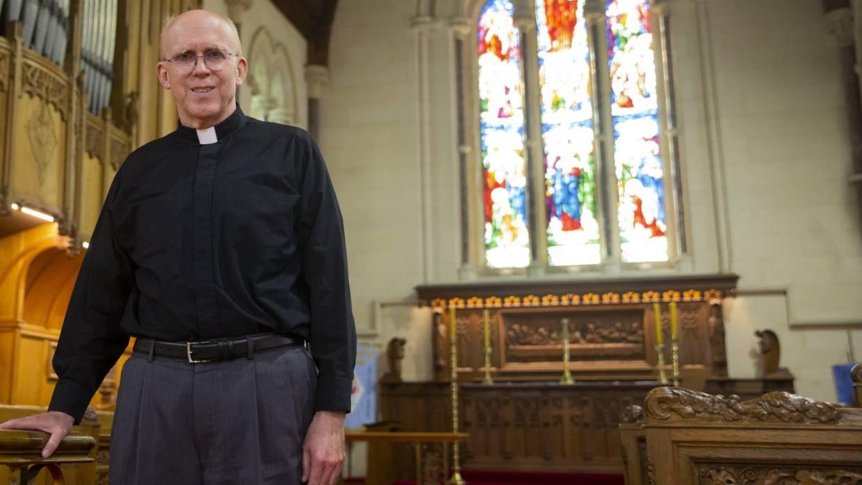Reverend John Shoaf leaving St Mary's Church for the United