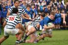 Southland Boys' High School flanker Jack Wilcox is tackled by Otago Boys' High School's Caleb Hughes during the ...
