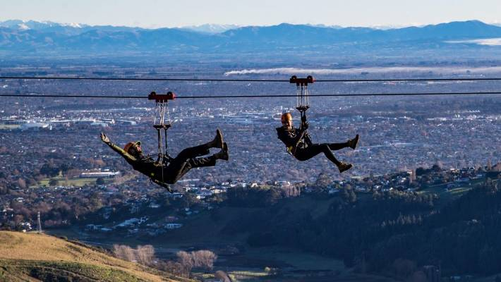 Backpackers have traditionally scrimped on accommodation so they can afford to spend more on activities such as zip lining at the Christchurch Adventure Park.