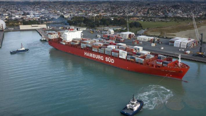 Port of Timaru tugs pull the giant Rio de Janeiro container ship away from the wharf for its departure.