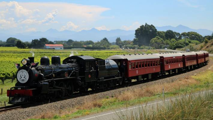 The Marlborough Flyer is a splendid sight as she puffs along the track between Blenheim and Picton, whistling at level crossings.