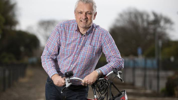 Simon Kingham says in 2030, people living in the central city will be using more shared vehicles, such as e-bikes and e-scooters.