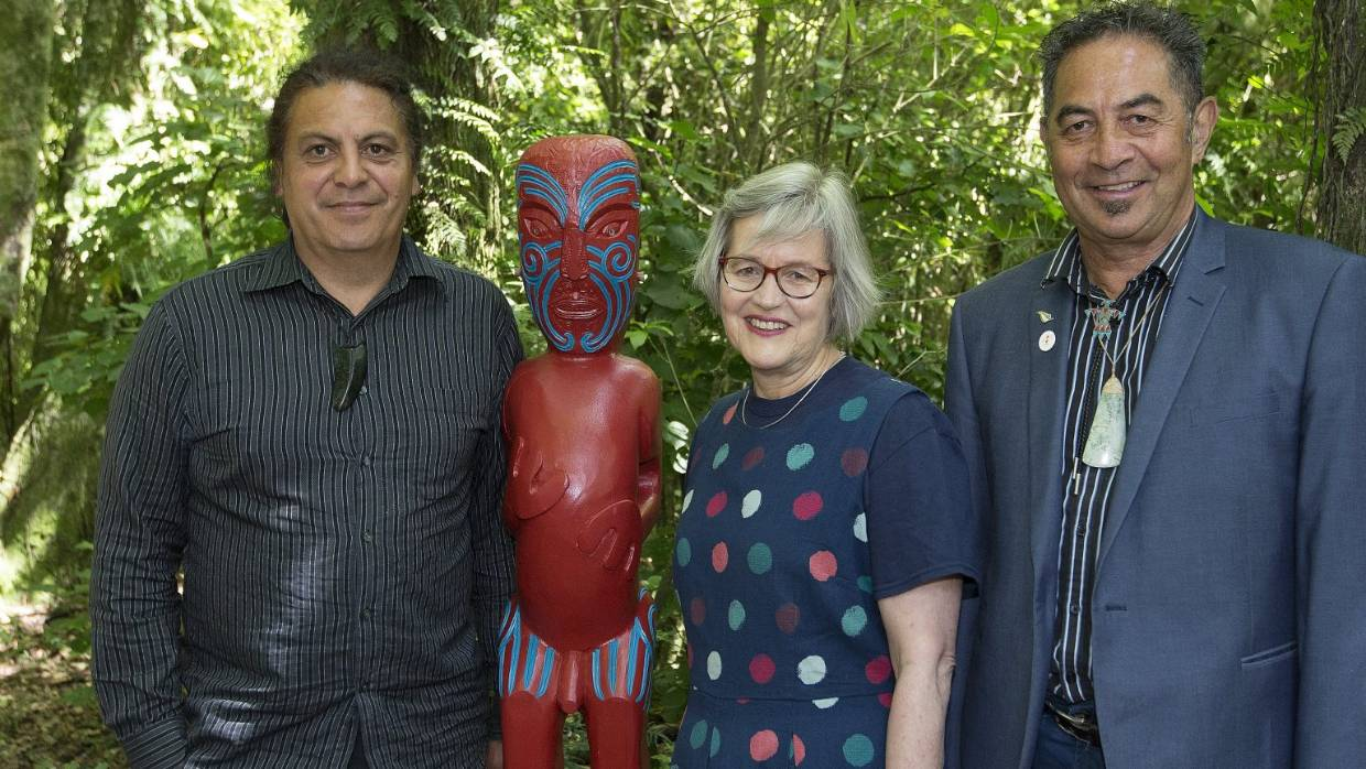 Rangitāne carver Craig Kawana, left, Conservation Minister Eugenie Sage and Te Manawa executive Hone Morris with the sculpture Milton Wainwright believed to be obscene and an affront to Christian decency. — Photograph: Murray Wilson.