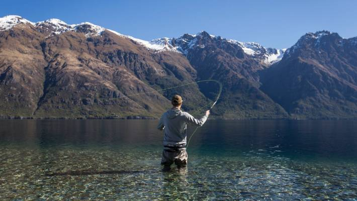 A fly fisherman on the southern shores of Lake Wakatipu in Queenstown.