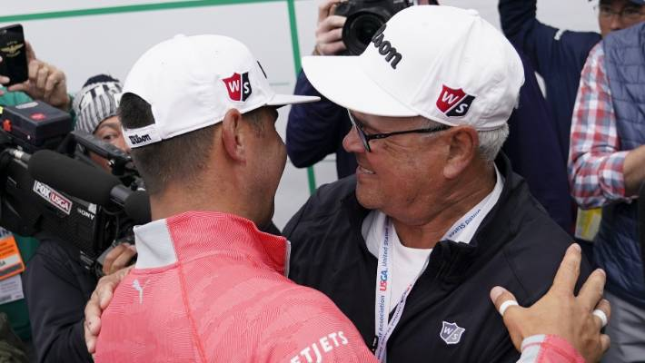 Gary Woodland is congratulated by his dad, Dan.