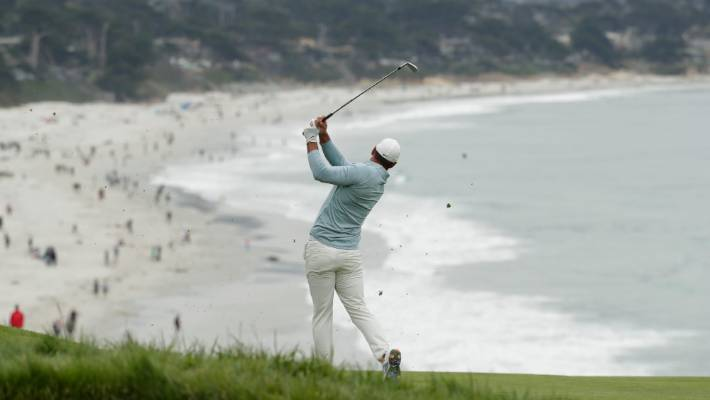 Brooks Koepka hits from the fairway on the ninth hole at Pebble Beach in California.