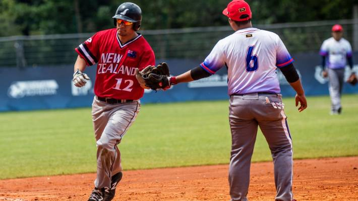 Black Sox captain Nathan Nukunuku rounds the bases after hitting one of two automatic home runs against the Philippines in 2019.