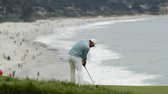 Brooks Koepka hits from the fairway on the ninth hole during the final round of the US Open Championship at Pebble Beach.