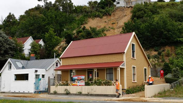 The slip in 2011 followed a major deluge across Nelson. Judith Collins and David Wong-Tung's property is the white cottage on the left.