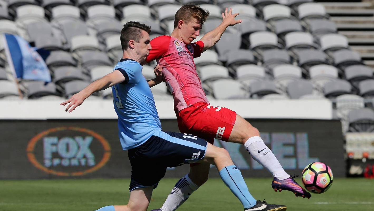 Wellington Phoenix raid Sydney FC by signing youth team captain Liam McGing
