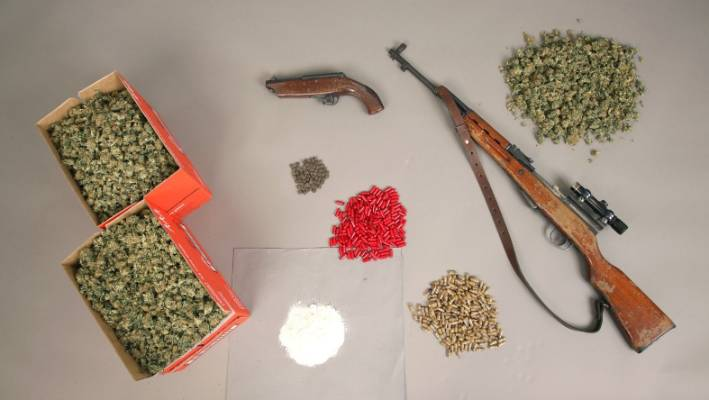 Police seized drugs, cash and firearms as part of Operation Crimson.