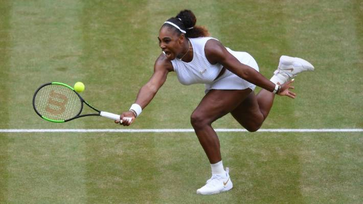 Serena Williams stretches to return in a ball in the Wimbledon women's final.