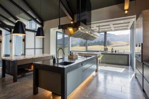 The winning kitchen features two islands, one of which has a teppanyaki grill and a commercial-grade stainless steel ...