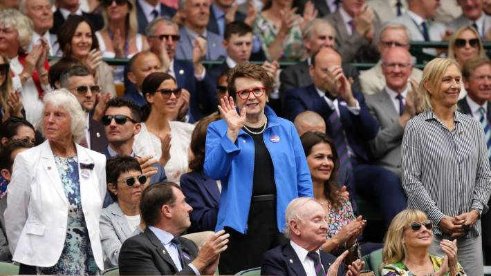 Tennis legends Ann Jones, left, Billie Jean King and Martina Navratilova stand up after being announced to the crowd on Centre Court at Wimbledon in 2018.