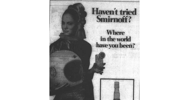 A female cosmonaut enjoys a glass of vodka in Smirnoff's ad.