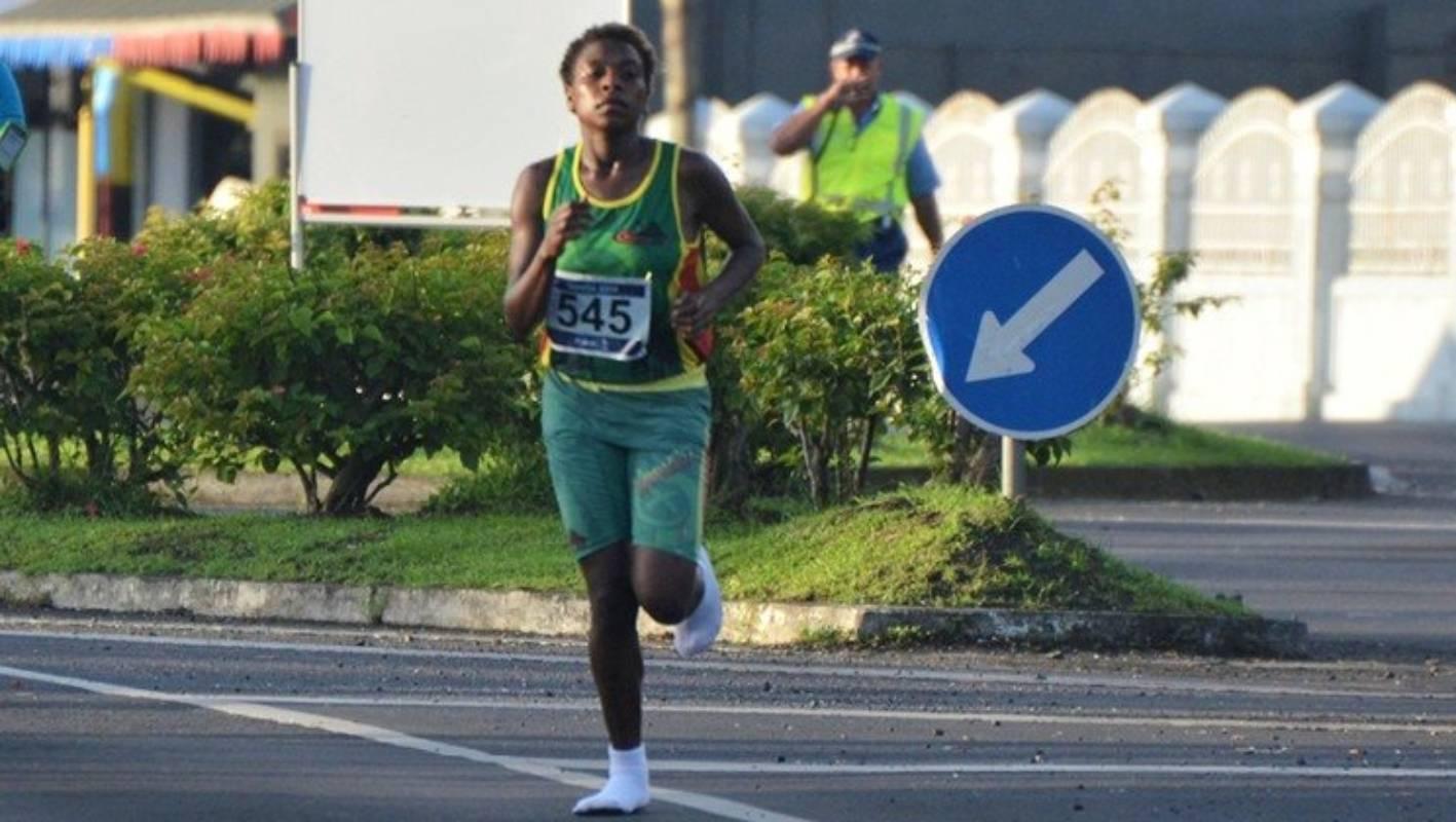 Vanuatu woman wins Pacific Games half marathon wearing only socks on her feet