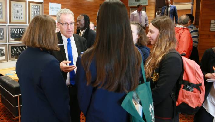 Secondary school students speak with Hamilton Mayor Andrew King at the council's climate change meeting.