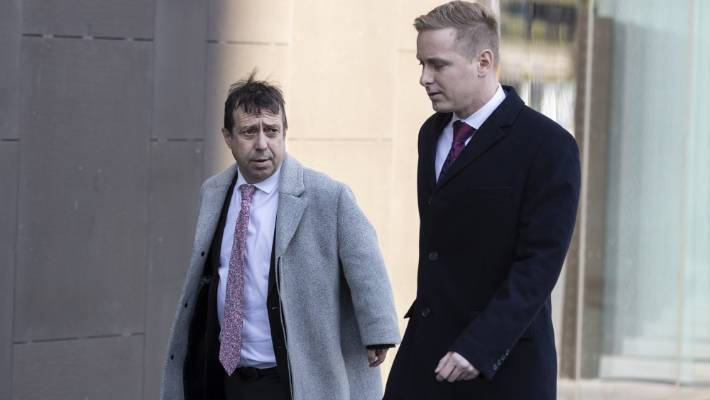 Lawyers for the accused Shane Tait, left, and Jonathan Hudson arrive at the Christchurch High Court.