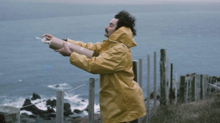 Dave Lowe taking an air flask sample at the edge of the Baring Head cliff in 1972.