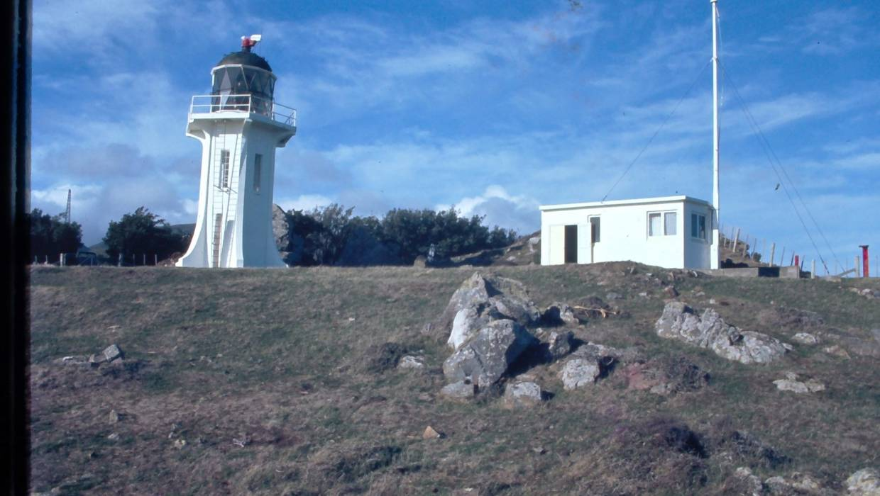 The Baring Head lighthouse and research station in 1972. Air samples were taken at the top of the flagpole and atmospheric CO² concentration was measured by an infra red analyser in the building. — Photograph: Dave Lowe.