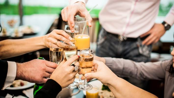 Research shows Kiwis are drinking less alcohol than we used to but spending more on food and other entertainment.