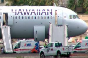 Hawaiian Airlines Flight 47 on a runway after smoke filled the plane's cabin.