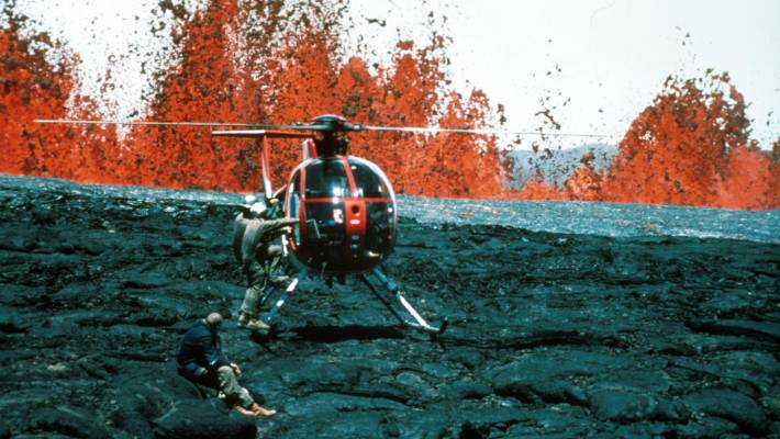 Geologists escape Manua Loa aboard a rescue helicopter during the 1984 eruption.