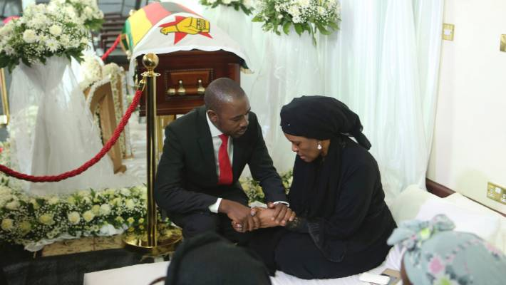 Nelson Chamisa, left, leader of the main opposition party in Zimbabwe, consoles Grace, wife to former Zimbabwean leader Robert Mugabe.
