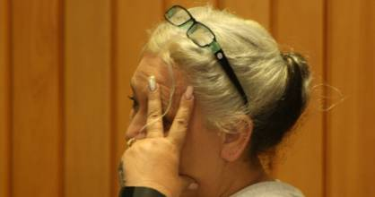 Tracey Livingstone, pictured at an earlier hearing, admitted to theft and making a harmful digital communication.