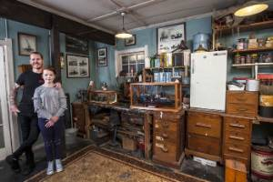 Chris Mathers and daughter Madie, 10, in the re-creation of his grandfather's basement workshop.