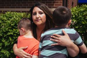 Danielle Rizzo with her boys, ages 6 and 7, in Illinois, United States. After finding out her sons were part of an ...