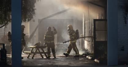 Firefighters dampening down a classroom block at Russley School in Christchurch.