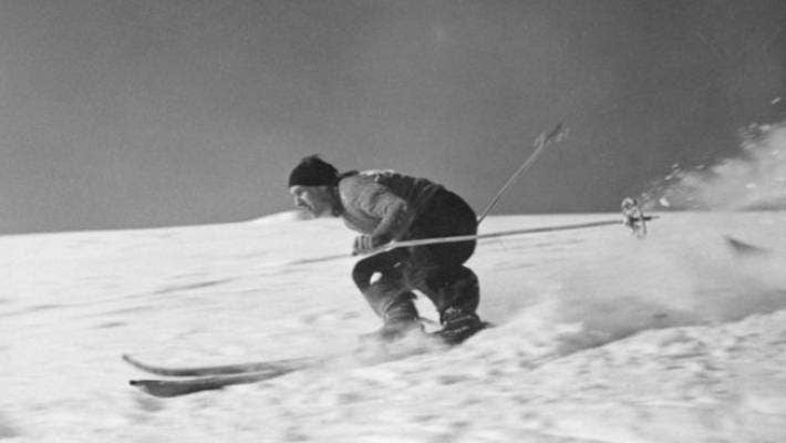 A man skis on the Rangiwahia Ski Club grounds on the Ruahine Range in the 1930s. The photo was taken by Bruce Valentine Davis.