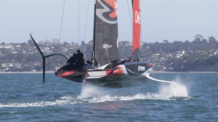 Team New Zealand foiling under sail power for the first time during a successful testing session in Auckland.