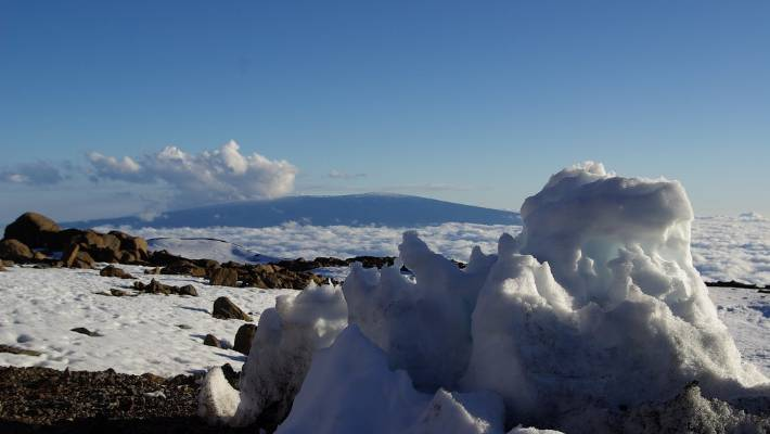 The long, sloping sides of Mauna Loa, seen from the summit of its sister mountain, Mauna Kea.