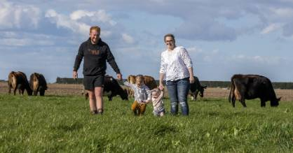 James and Chloe Davidson with their children Angus, 2, Margot, 10 months, in the paddock at their rural Canterbury farm.