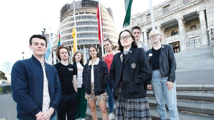 The 'Make It 16' campaign will be launched at  Parliament tomorrow. Co directors Dan Harward Jones, 17, front left and Gina Dao-McLay 16, front right, are pictured with, from left, Jackson Graham, 20,  Lily Stelling, 18, Rebecca Matijevich, 19, Ella Flavell, 18,  Pierson Palmer, 17, and Olivia Trass, 17.