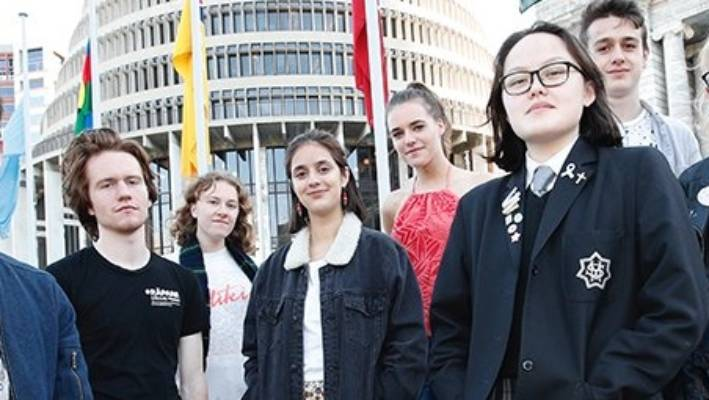The 'Make It 16' campaign was launched at Parliament on Friday. Co directors Dan Harward Jones, 17, front left and Gina Dao-McLay 16, front right, are pictured with, from left, Jackson Graham, 20, Lily Stelling, 18, Rebecca Matijevich, 19, Ella Flavell, 18, Pierson Palmer, 17, and Olivia Trass, 17.