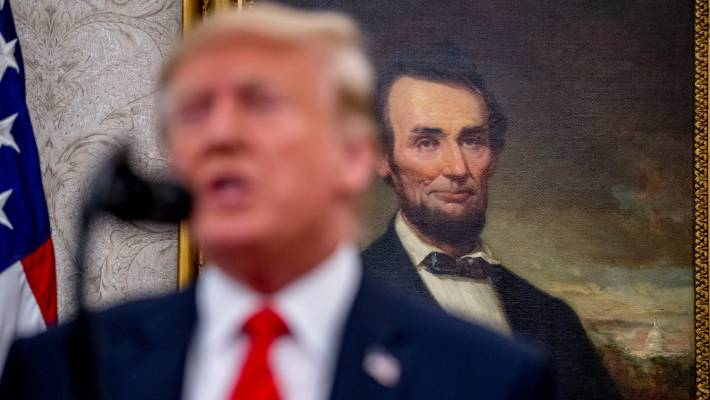 "Donald Trump speaks with the country's first Republican President, Abraham Lincoln, ""looking"" over his shoulder. — Photograph: Associated Press."