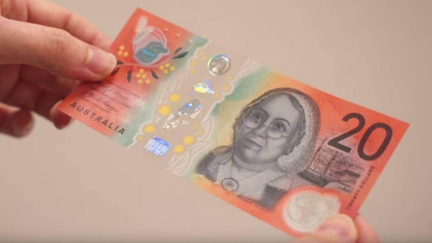 Australia's new $20 note gets an awkward outing to buy bananas