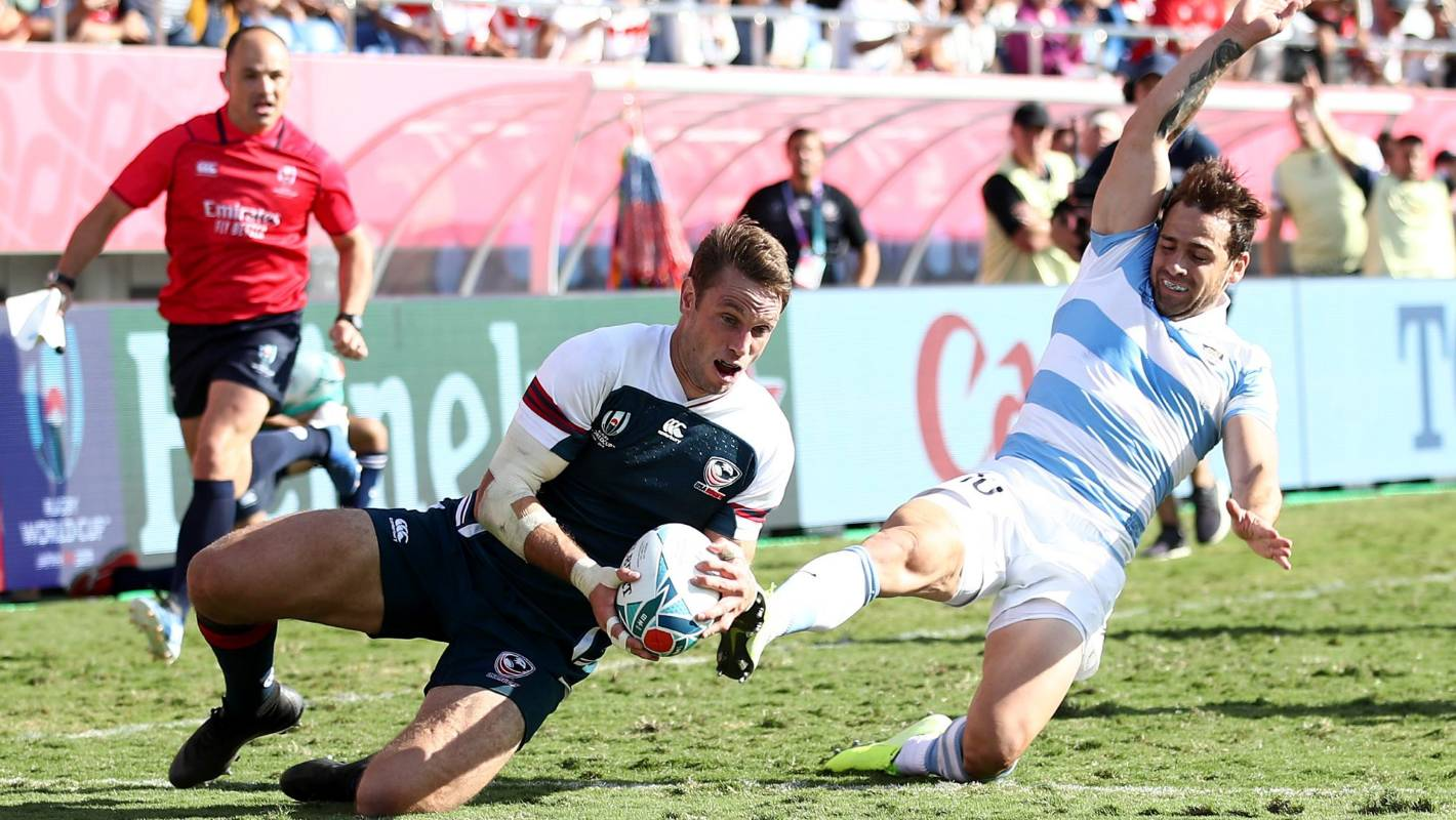 Assistant referee Jaco Peyper narrowly avoids being slam-dunked by USA captain