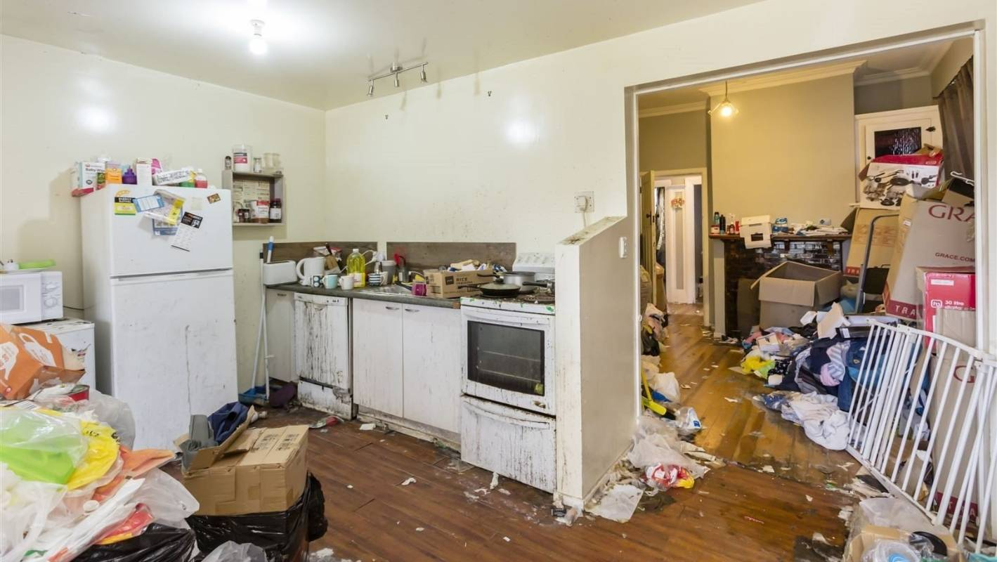 Mystery after squatters leave abandoned Dunedin property covered in rubbish