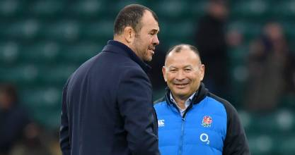 Eddie Jones head coach of England and Michael Cheika (L) head coach of Australia talk on the pitch  in 2018.