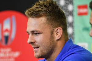 Sam Cane speaks to the media in Tokyo on Monday as the All Blacks launched quarterfinal week.