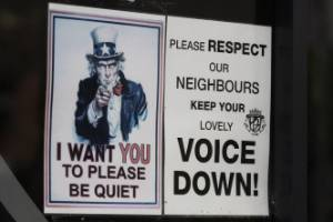 A sign pleading with patrons to keep their voices down at Plush KTV bar in Auckland.
