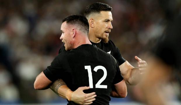 YOKOHAMA, JAPAN - SEPTEMBER 21: Ryan Crotty of the All Blacks hugs Sonny Bill Williams after being taken off during the ...