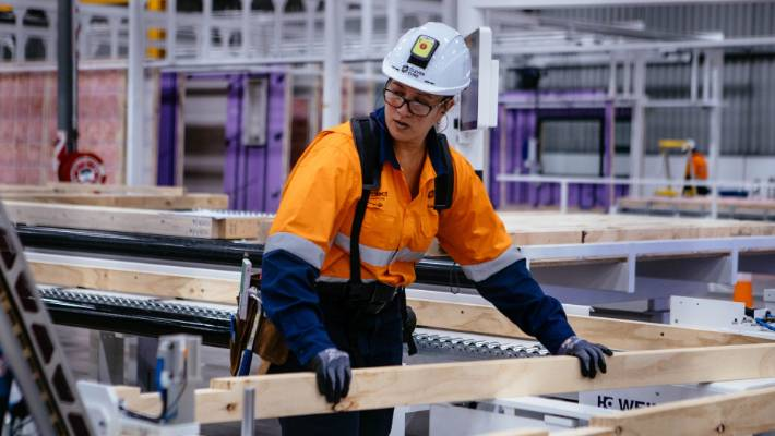 """Strength is not an issue for workers building homes in the high-tech Fletcher Building """"Clever Core"""" factory in Auckland."""